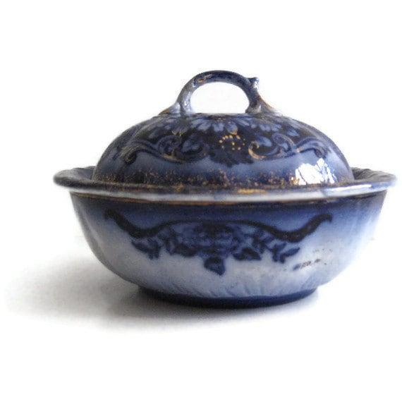 Vintage flow blue butter dish with gold trim