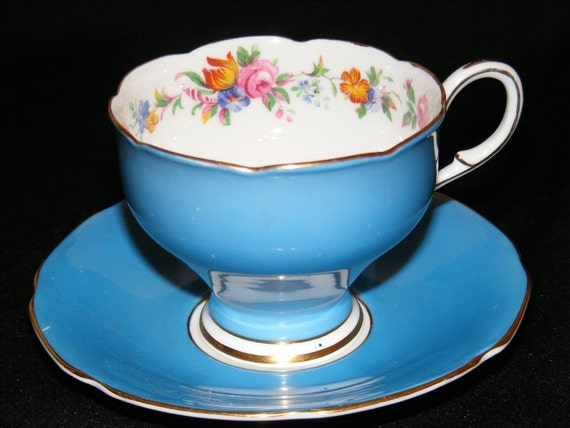 Paragon teacup and Saucer Blue with floral pattern within circa 1949-1952