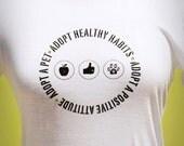 Women's 'Adopt Healthy Habits, Adopt a Good Attitude, Adopt a Pet' Bella White Tee Shirt with Swarovski Crystals