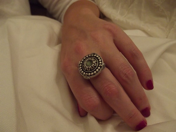 vintage button ring in 4 prong setting w/green cats eye bead & flower ring band.  MJ442/AJ45