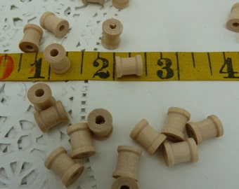 20 tiny wood spools bead size perfect for jewelry making.