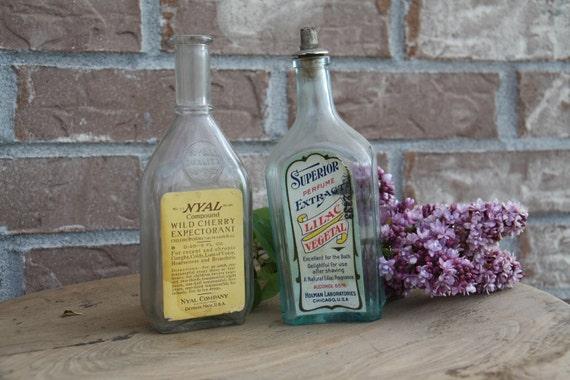 Two Vintage Apothecary Bottles