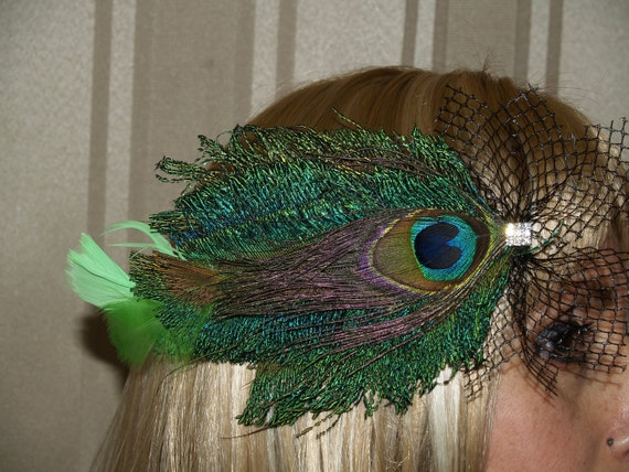 Head Piece Peacock feathers it looks like a fish