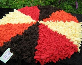 """Rag Rug fleece on jute backing. Circular 27.5"""" diameter. Red, Orange, Lemon and Brown"""