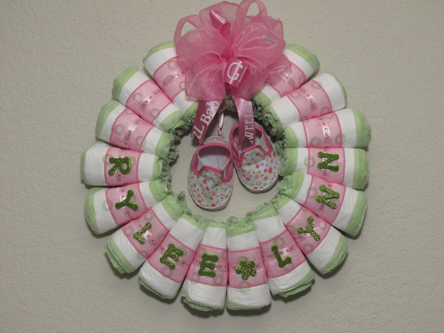 small rolled baby girl diaper wreath by blissfulbunchesbyb2