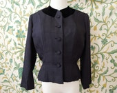 ON RESERVE: Flattering 40's short jacket with black velvet collar and cinched waist by Hannah Troy