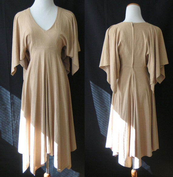 Lovely 60's / 70's forest nymph dress with handkerchief hem skirt and sleeves