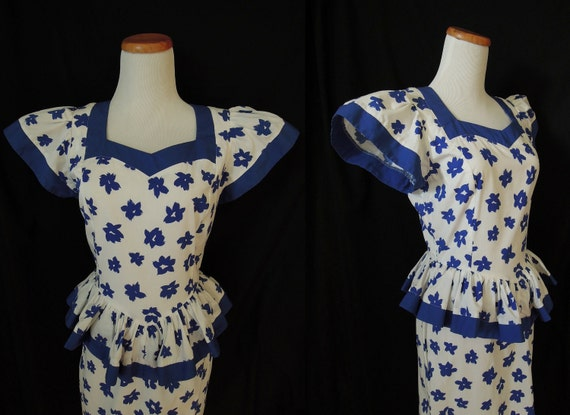 Super adorable 80's blue and white floral dress with ruffled peplum and sweetheart neckline