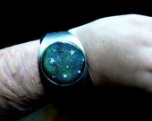 polymer clay and metal cuff bracelet - the universe around your wrist - celestial body on black polymer clay - galaxy 'print'