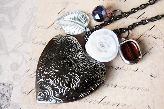 Dark romance - a black and white heart locket necklace