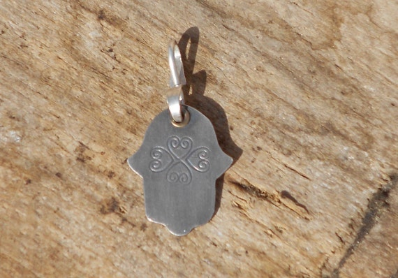 Silver Hamsa pendant with heart design