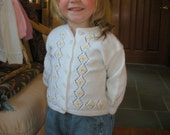 Dainty Swedish pattern hand knit toddler sweater with embroidered flowers in yellow