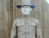 Real Photo POSTCARD  WWl Soldier in UNIFORM 1918 Sepia brown