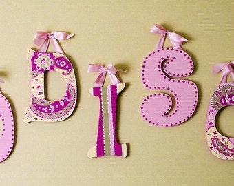 A Set of 7 Hand Painted Wooden Letter Wall Hangings