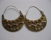 Hand Forged tribal hoop earrings. Two sided Brass copper and sterling silver