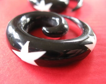 Tribal Carved horn gauged earrings. Gauge size 00 . Stunning black with white stars