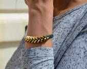 Designer Braided Hex Nut with Deerskin dark green leather lace and fancy gold hardware closures.