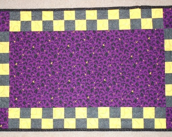 Purple Bat with Black and Yellow Checkerboard Table Runner