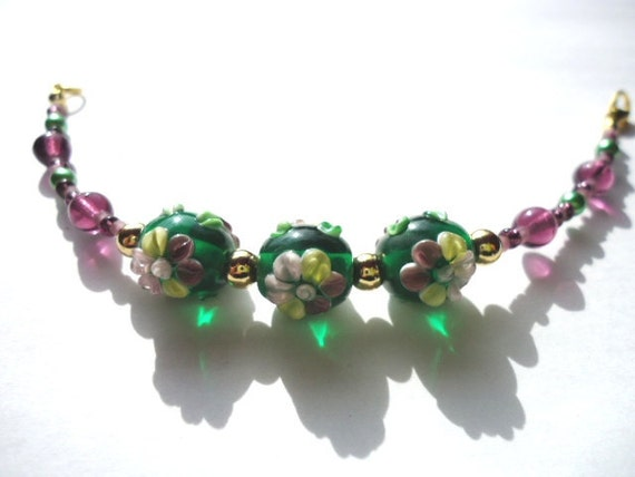 Bracelet Handmade Purple and Green Glass Lampwork Bead Flower by JulieDeeleyJewellery on Etsy