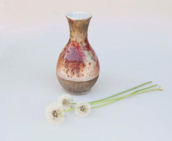 red bottle vase