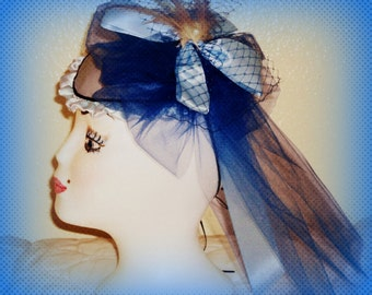 Blue silk teardrop hat with tulle, netting, ribbon and feathers