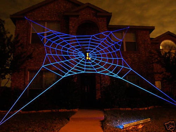 33 ft ultra glowweb giant halloween spider web house prop. Black Bedroom Furniture Sets. Home Design Ideas