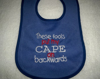 Blue Bib - These Fools Put My Cape on Backwards - Baby Girl or Boy Bib - Blue Bib with Red and White Embroidery
