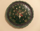 Wall clock - decoration - wooden frame - clay clock face pressed out of hand formed molding - hand painted motifs.