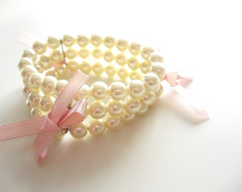 Shabby chic romantic pearl bracelet- three layers of pearls-round pearls pink bows