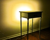 Light Green Side Table with Flip Top and Built-In Lighting.