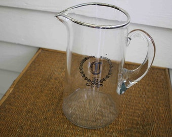 Vintage silver-rimmed pitcher
