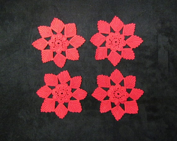 Flower appliques, 4 crocheted red motifs, early 1900's