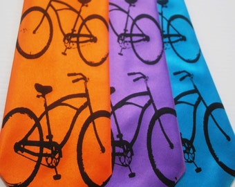 Riding bikes with you silkscreen neckties. Bright colors microfiber screen printed bicycle tie black ink.
