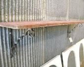 Heavy forged steel shelf brackets.  Original design by Mike Hill, Artist Blacksmith