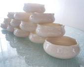 Antique Porcelain Salt Cellars in set of 13 Cream color