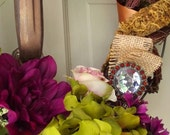 """16"""" Twisted grapevine wreath decorated with satin and moss ribbon, silk flowers and jewelry finds and brooches"""