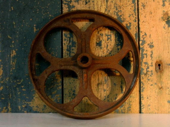 Cast Iron Wheels And Gears : Vintage cast iron belt wheel gear rusty and round garden art