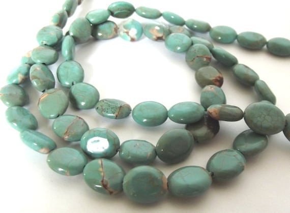 "Turquoise Howlite Oval Shaped Beads, measuring 7x9mm - 15"" Strand"