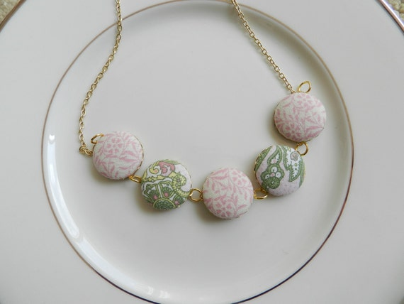 Covered button necklace in mint and pink