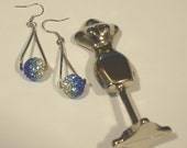 Swarovski Crystal Charm Earrings: Blue Crystal Party Dangle Earrings made with charms encrusted with Swarovski Crystals