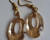 Swarovski Dangle Earrings: Chic Loops Collection (Light Gold) Made with faceted Swarovski Crystals and yellow gold chain