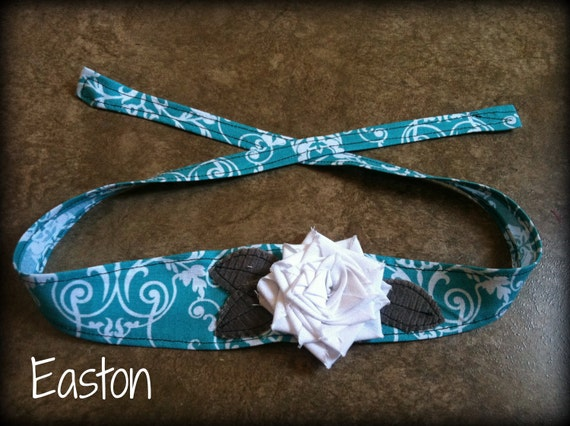 Shabby chic blue and white damask headband with a white fabric flower and gray leaves