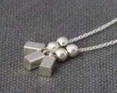 Sterling silver necklace: everyday jewelry with round beads and tiny bars