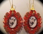 Earrings portrait of Salvador Dali in glass cabuchon fixed on plastic frame handmade painted and decorated. The hocks are in golded silver