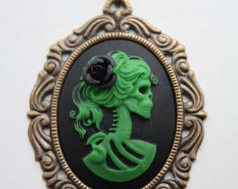 Zombie lady skeleton cameo pendant - with black rose in her hair -