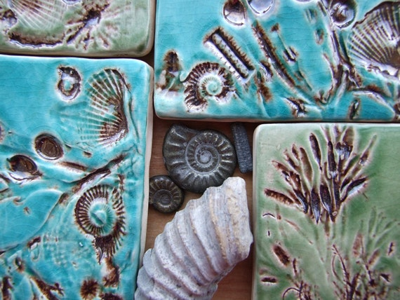 4 coasters, shells, fossils and seaweed from the Jurassic coast, glazed with bronze and green and turquoise crackle glaze MADE TO ORDER