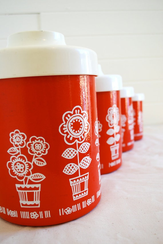 set of four red and white floral canisters with lids.  vintage 70s style. great for your kitchen countertop or for unique storage.