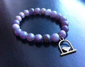 beaded bracelet with Swinging Bird charm