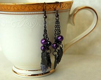 Dangly black, purple and leaf glass pearl earrings