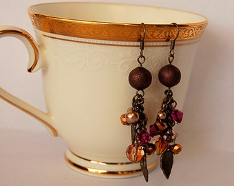 Pink, purple, gold and bronze Swarovski dangle earrings